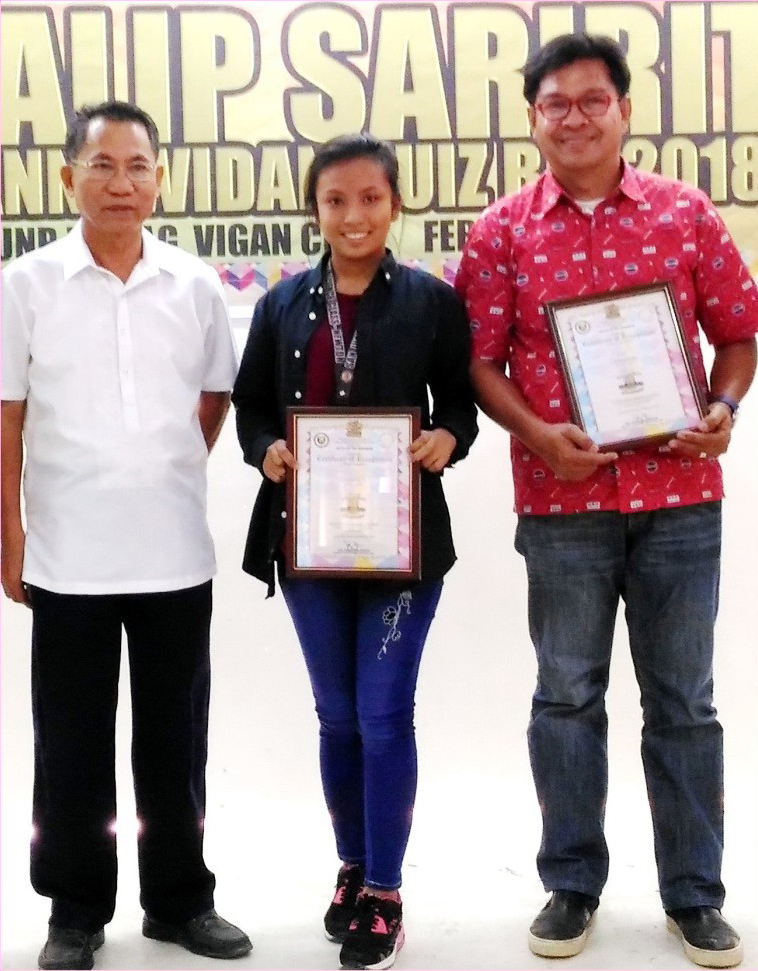 Iloko-Poetry Writing Champ Jonabelle Manabat (center) of San Juan NHS is flanked by her Coach Edward Antonio (right) and Ilocos Sur Historical Committee Chief Convenor Amado Naval during the awarding ceremonies at the University of Northern Philippines, February 2.
