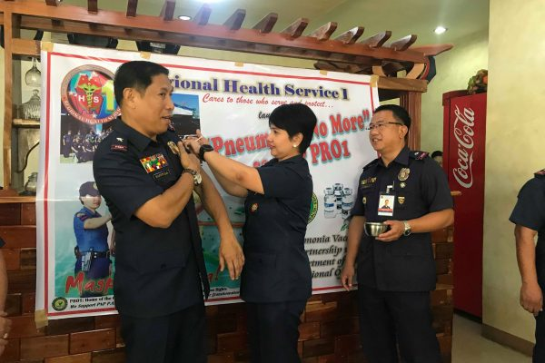 PRO1 Regional Director, PCSupt Romulo E Sapitula leads the vaccination