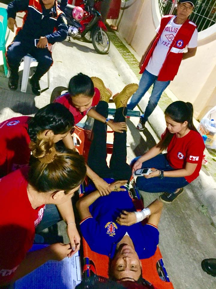 Photo: Members from the Philippine Red Cross gives first aid to an adult who collapsed during the mass inside the Panpantoc Public Cemetery at Barangay VI, Pagburnayan,Vigan City, Ilocos Sur/photo Omar Anthony T. Aquino
