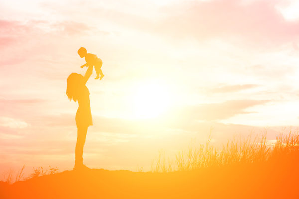 Stock photo: Silhouette of mother and daughter