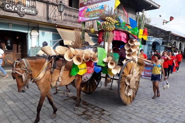 Calesa parade along Crisologo St., Vigan City, Ilocos Sur (photo by Jasper Allibang Espejo)