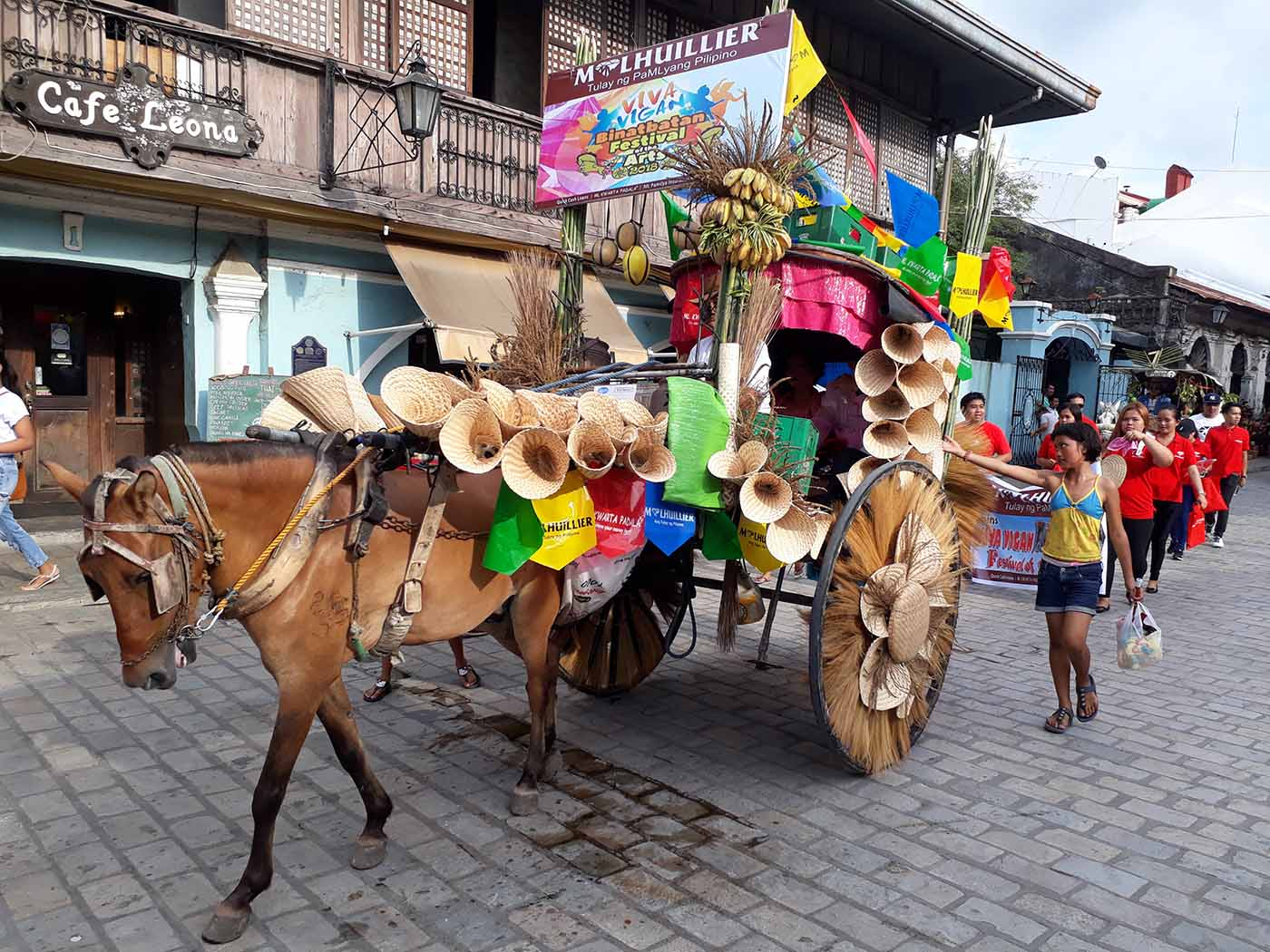 Calesa parade along Crisologo St., Vigan City, Ilocos Sur (photo by Jasper Allibang Espejo)